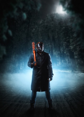 vindictive: Evil embodiment in hockey mask and leather coat Stock Photo