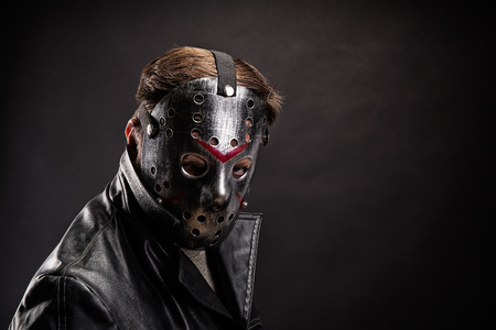 Bloody murderer in hockey mask portrait Stock Photo