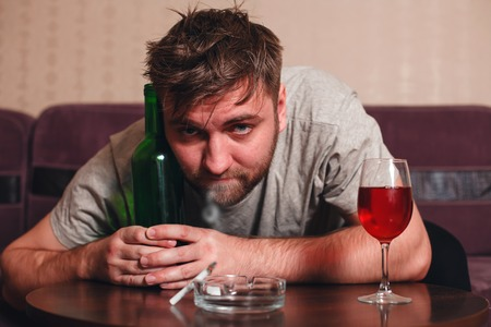 drunkenness: Anonymous alcoholic person in depression