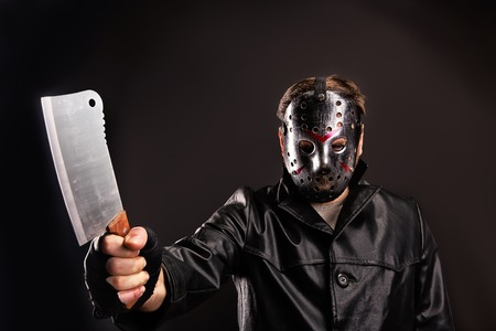 vindictive: Murderer in hockey mask with meat cleaver in hand
