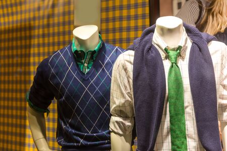show window: Male mannequins in modern youth clothes