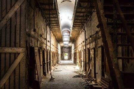 incarceration: Old prison dark hallway