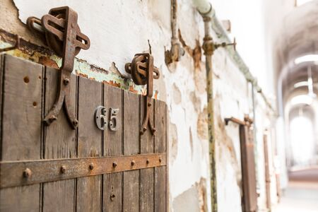 Wooden door of old prison cell closeup. Stock Photo