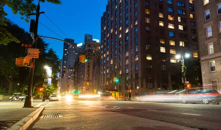city building: New York City street at night time Stock Photo
