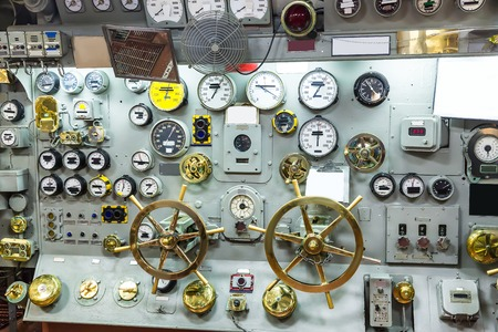 engine room: Military ship control panel with gauges.