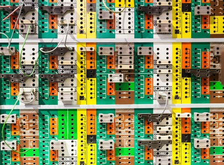 switchboard: Panel with many colorful sockets.