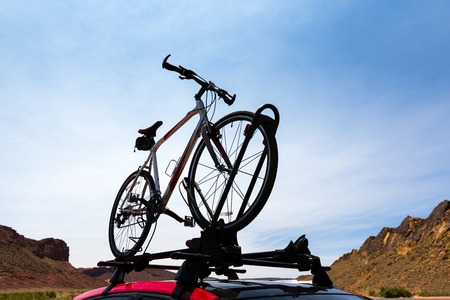 touring car: Bike transportation on the roof of a car. Stock Photo