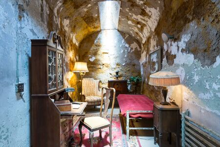 old furniture: Old jail cell with furniture.
