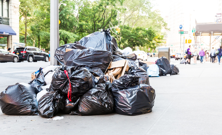 Pile of garbage bags on city street. Stock Photo
