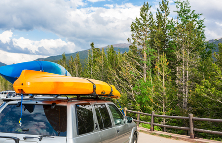 transported: Boats on top of a car. Stock Photo