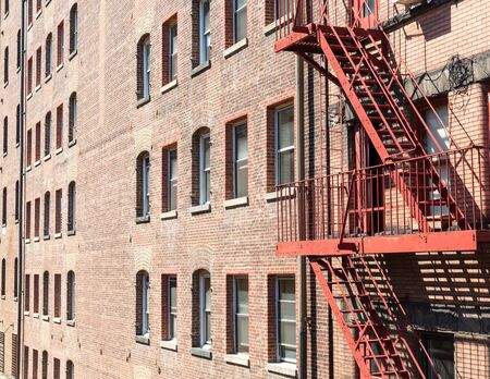 brick building: Closeup of brick building with fire ladders.