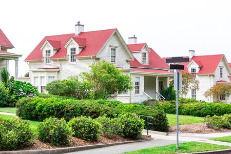 suburban neighborhood: Gently slanted lawn in front of cozy house.