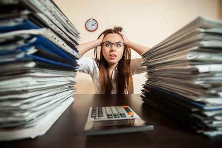 doomed: Doomed accountant against big stacks of documents