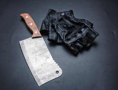 vindictive: Meat cleaver and fingerless leather gloves