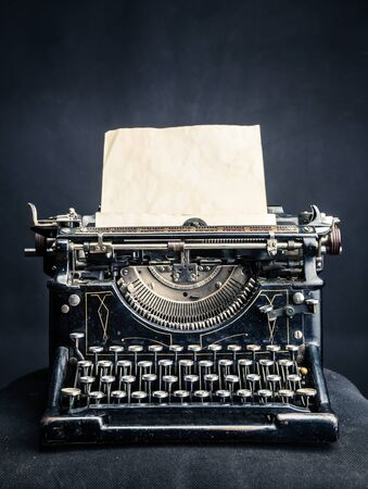 typewrite: Vintage black typewrite with inserted paper sheet