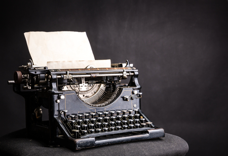 typewrite: Antique grunge typewrite with inserted paper sheet