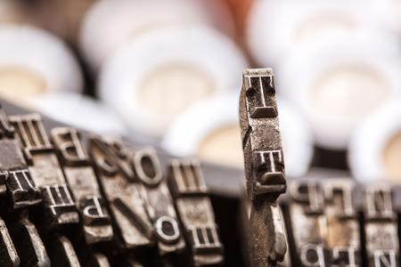typewrite: Retro writing machine type bars closeup Stock Photo