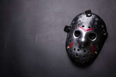 Hockey mask of serial killer isolated on black Stock Photo - 73610498
