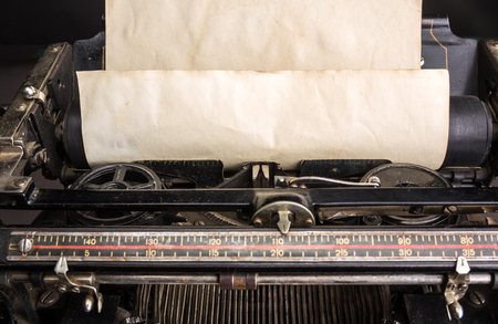 typewrite: Old typewriter mechanism with inserted paper