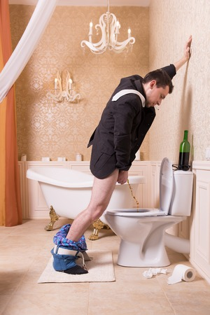 Funny drunk man urine in the toilet bowl Stock Photo