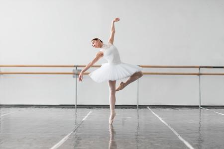 Female ballet dancer keep the rack in class