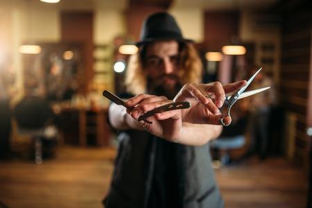 barber scissors: Barber with scissors and straight razor in hands Stock Photo
