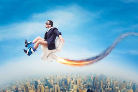 Man in pilot glasses flying on a jet toilet bowl