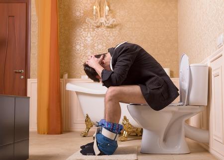 Diarrhea or constipation problem, man on toilet