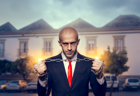 Silent killer with iron chain in hands Stock Photo