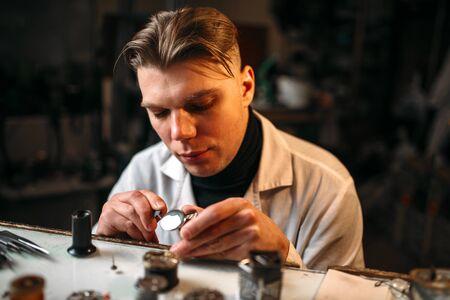 pinzas: Watchmaker repair broken clockwork with tweezers