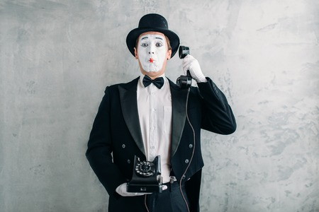 comedian: Pantomime actor performing with retro telephone