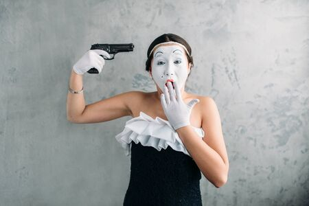 comedian: Mime female artist performing with gun