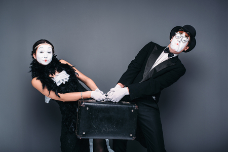 comedian: Mime actor and actress performing with suitcase