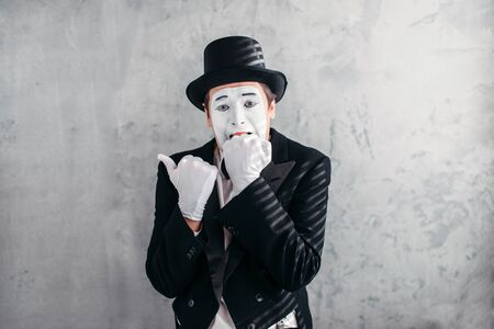 mimic: Mimic male person with white makeup mask Stock Photo