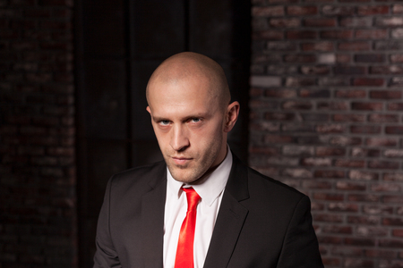 felonious: Contract killer in suit and red tie