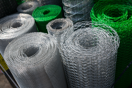 Barbed wire and mesh netting rolls