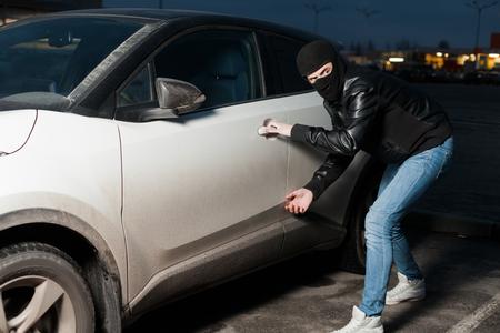 Carjacking danger, car insurance concept