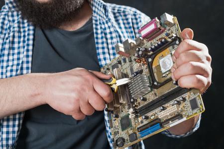 skill: Service engineer repair pc motherboard Stock Photo