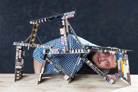 Engineer builds house of cards from motherboards Stock Photo