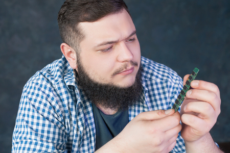 skill: Service engineer fixing problem with pc hardware Stock Photo