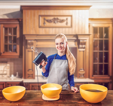 adds: Woman in apron adds sugar into bowl, dough making Stock Photo