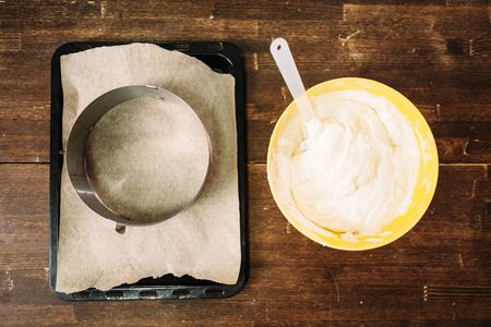 cookie sheet: Fresh dough in bowl and pan with parchment paper