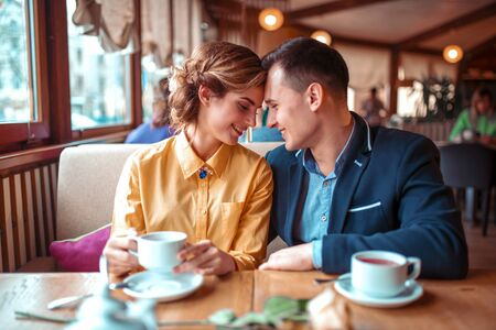 romantic date: Happy couple, romantic date in restaurant Stock Photo