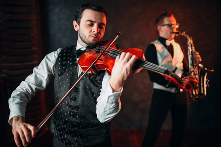 Jazz man and violinst, classical musical duet Stock Photo