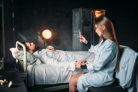 health professional: Female doctor with syringe against male patient Stock Photo