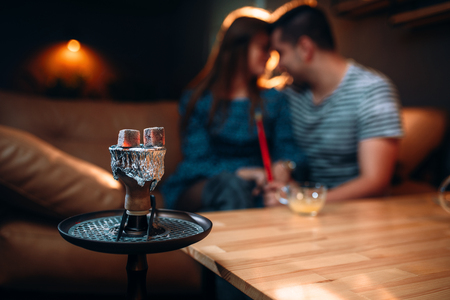 Young couple relax and smoking hookah 스톡 콘텐츠