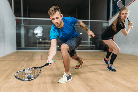 Squash game training, players with rackets 스톡 콘텐츠