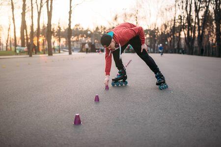 rollerskater: Roller skater in skates, balance exercise Stock Photo