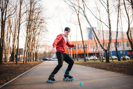 rollerskater: Roller skater legs in skates on asphalt walkway