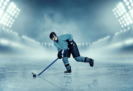 frozen lake: Ice hockey player in equipment poses on stadium Stock Photo